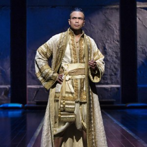 "In this image released by Lincoln Center Theater, Jose Llana appears during a performance of ""The King and I."" Llana, 39, has stepped into a role made famous by Yul Brynner, who was king for more than 4,600 performances. But the younger actor has made the king his own, even purposely standing slightly differently than Brynner?s famous akimbo stance. (Paul Kolnik/Lincoln Center Theater via AP)"