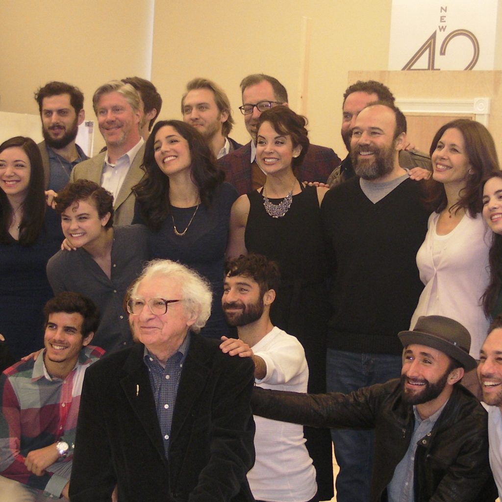 The cast pose with Sheldon Harnick.